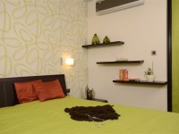 Ajtonyi Rita lakberendező belsőépítész referencia fotói | Olasz bútorokkal - Modern zöld háló polcokkal
